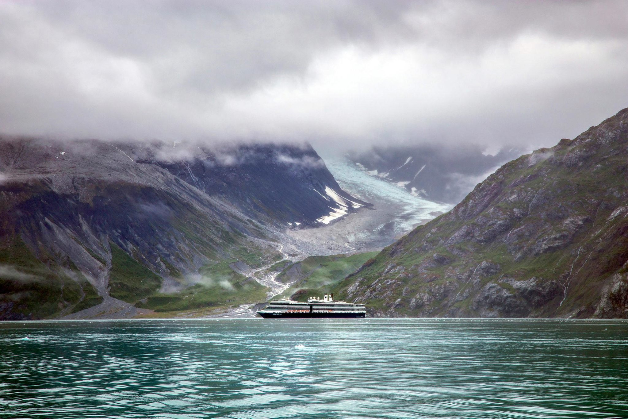 Large vessel with glacier in the background